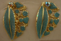 Gold-metal-01-2BL-with-blue-glitter-painted-carved-leaf-detail.-44-x-28mm[1]